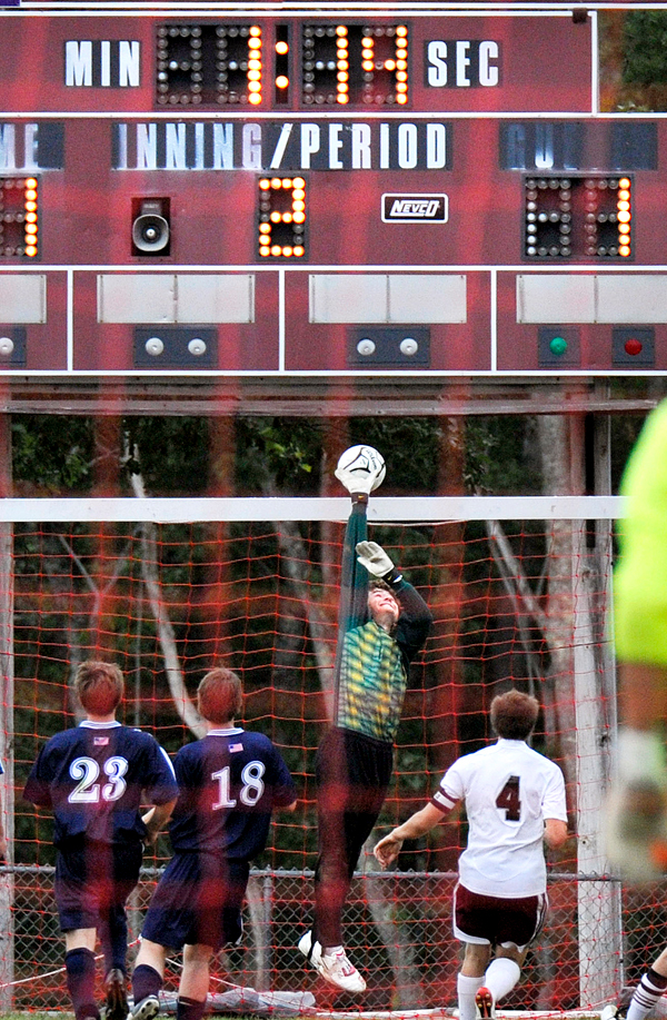 With 1 minute 14 seconds on the clock in second overtime Presque Isle keeper Dillon Kingsbury deflects a shot over the crossbar to preserve a 1-1 tie in theur game versus Ellsworth, Saturday, Sept. 12, 2009.  BANGOR DAILY NEWS PHOTO BY MICHAEL C. YORK