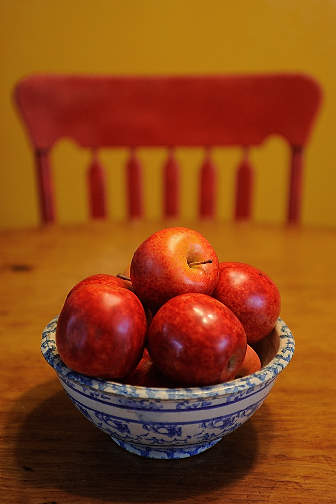 A bowl of faux apples provides one of many splashes of warm inviting colors in the kitchen of the Ellen and Bruce Flagg's 160-year-old farm house in Veazie. TheFlagg's home is on this year's EMMC kitchen tour on September 26 from 1-4 p.m. to benefit Eastern Maine Medical Center. Photographed September 13, 2009. (Bangor Daily News/ John Clarke Russ)