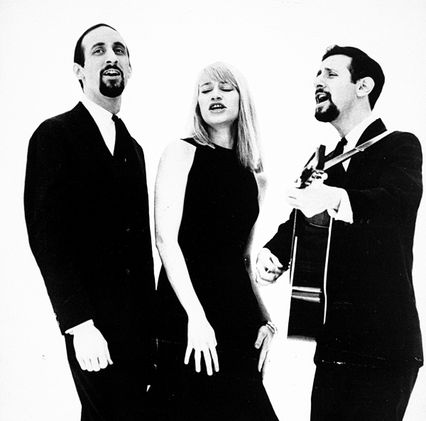 FILE - This 1965 file photo shows, from left:  Peter Yarrow, Mary Travers and Paul Stookey. Travers, one-third of the popular 1960s folk trio Peter, Paul and Mary died Wednesday, Sept. 16, 2009 in a Connecticut hospital after battling leukemia for several years. She was 72. (AP Photo)