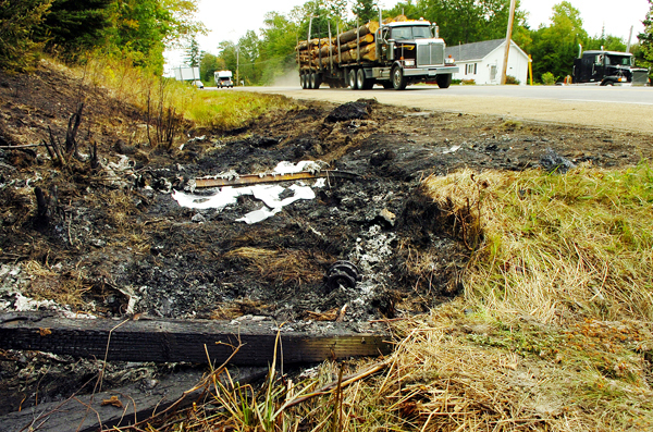 A charred section of ditch next to Route 1 in Stockton Springs is seen Friday, Sept. 18, 2009 where a fatal head-on collision occured Thursday night. According to the Waldo County Sheriff's Office, a pickup truck driven by Chadwick Sage was traveling northbound on Route 1 when it crossed the center line into the path of a commercial delivery truck driven by Richard Turner of Thomaston. After the crash, the delivery truck rolled over and burst into flames. Sage died at the scene while Turner was taken by ambulance to the Waldo County General Hospital. The extent of his injuries was unclear Friday. (Bangor Daily News/Bridget Brown)