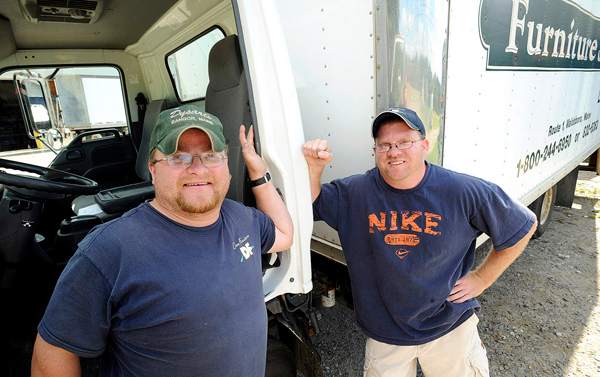 Gary Nisbet, 35, left, and Randy Joubert, 36, work at Dow Furniture in Waldoboro on Thurdsay, September 17, 2009. They found out two weeks ago that they are, in fact, brothers who were each raised by separate adoptive parents.  Randy searched the state database in January to find out about his birth parents and was told that he had a brother, but he was only given a first name for his sibling.  They have been working together since July of this year, riding in the same delivery truck.  Eventually Randy asked Gary about his birthday and parents after many of the store's employees commented on the fact that they looked like brothers. (Bangor Daily News/Gabor Degre)