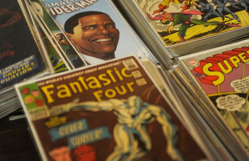 A recent Spider-Man comic featuring Barack Obama is displayed among other comics at the booth at the BangPop Comic Book and Pop Culture Convention on Saturday at the Bangor Civic Center. The event continues 10 a.m.-5 p.m. Sunday. Buy Photo
