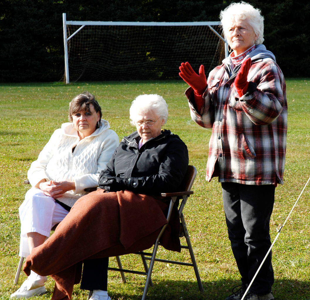 Traditional music filled the air at Riverside Park in Fort Kent on Saturday, Sept. 19, 2009 with Music in the Park as part of the town's annual Scarecrow Festival and University of Maine at Fort Kent homecoming weekend. Keeping time to the beat was Marilyn Harvey (right) with Elizabeth Sylvain (left) and Bernadette Morneault. (Julia Bayly photo)