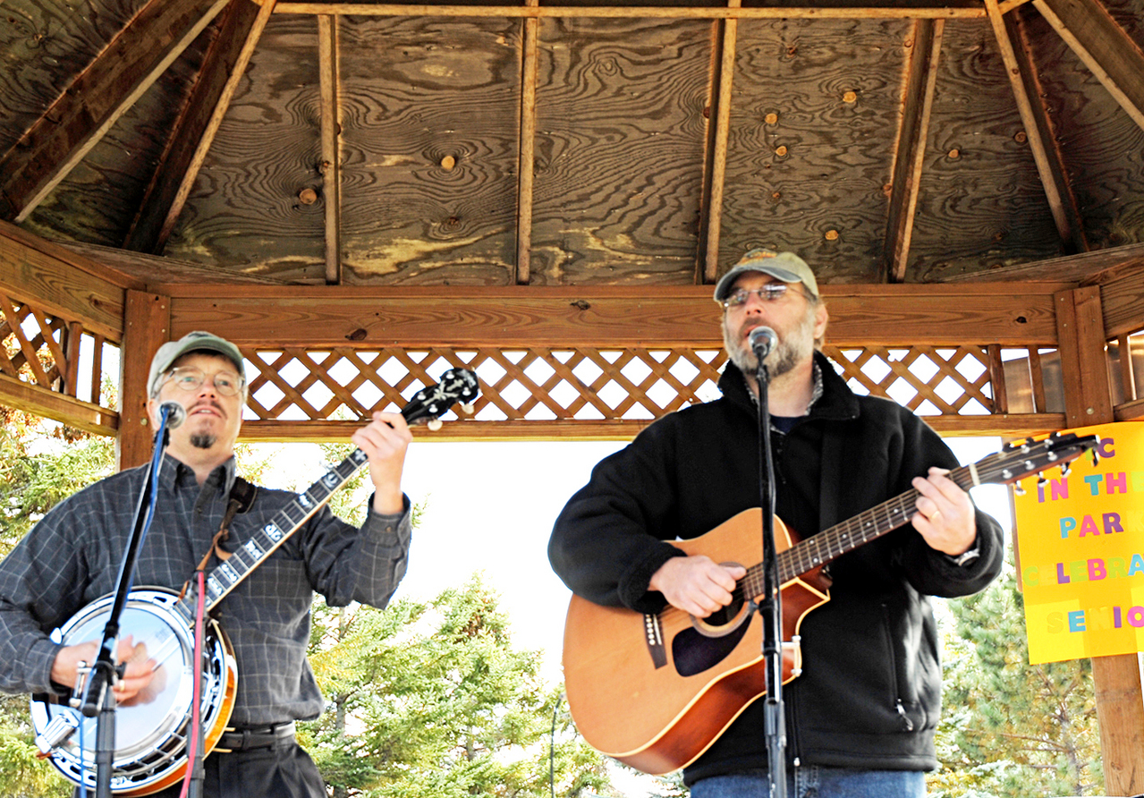 Among those performing at Saturday's Music In The Park in Fort Kent were University of Maine at Fort Kent professors Dave Hobbins (left) and Bruno Hicks who, together with Kurt Harvey (not pictured) are &quotValley Folk.&quot (Julia Bayly photo)