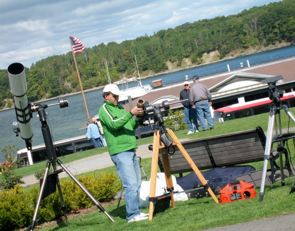 Marc Fisher of Norridgewock adjusts the settings on one of his three telescopes that were set up near the town dock in Bar Harbor on Saturday. Fisher, who owns a private observatory, was one of many participants of the four-day Acadia Night Sky Festival, which began Thursday and runs through Monday. Buy Photo