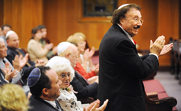 Max Furmansky (right) claps his hands in appreciation of the music performed by Phillip and Noreen Silver during a ceremony at Congragation Beth Israel in Bangor Thursday evening.  The event was held to honor Furmansky who has been the cantor of the congregation leading the High Holy Day services from 1998 until his retirement this year. (Bangor Daily News/Gabor Degre)