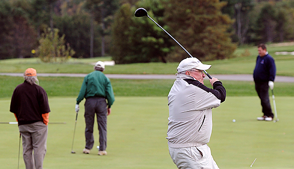 Jack May of Belfast tees off on the 10th hole during a golf tornament at the Penobscot Valley Country Club in Orono Friday.  The tournament and silent auction was held in memory of John P. Bishop of Castine, who passed away last year, and it helped raise awareness of Duchenne muscular dystrophy.  The proceeds from the auction benefit the Parent Project Muscular Dystrophy. (Bangor Daily News/Gabor Degre)