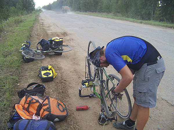 Roadside maintenance: From flat tires, broken racks, to brake problems, the two cyclists from New England have fixed many problems on the road. The cyclists carry cell phones so they can alert each other when problems arise. Unfortunately, the phones do not always work everywhere. Sometimes one cyclist carrying a certain tool that the other does not have gets ahead leaving the other behind. ( photo: courtesy of Levi Bridges)