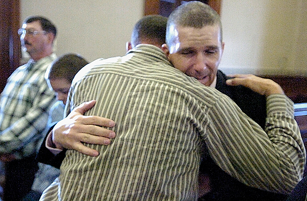 William G. York (facing camera) of Medway hugs Jimmy Russell Jr. following  James Lee's plea hearing for felony manslaughter at Waldo County Superior Court in Belfast Tuesday afternoon, September 29, 2009. Justice Jeffrey L. Hjelm rejected the plea bargain offered by state prosecutors and Lee's case will go to trial sometime next year. Rusell's brother, William Russell,28 , was killed instantly, Chad Brackett (not pictured) suffered cuts to his right arm and William York suffered a broken back when James Lee lost control off the truck and slammed into two trees and overturned in Monroe on September 22, 2008.  (Bangor Daily News/John Clarke Russ)