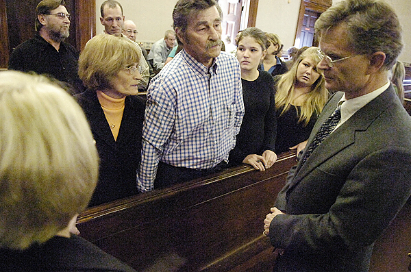Knox County District Attorney Geoffrey Rushlau , far right, talks with Donna Russell, her husband James Russell--both of Medway, and other family members following James Lee's plea hearing for felony manslaughter at Waldo County Superior Court in Belfast Tuesday afternoon, September 29, 2009. The Russell's son, William Russell, 28, was killed on September 22, 2008 and other paasengers injured when Lee lost control of his vehicle while unlawfully speeding. Justice Jeffrey L. Hjelm rejected the plea bargain offered by state prosecutors and Lee's case will go to trial sometime next year. (Bangor Daily News/John Clarke Russ)