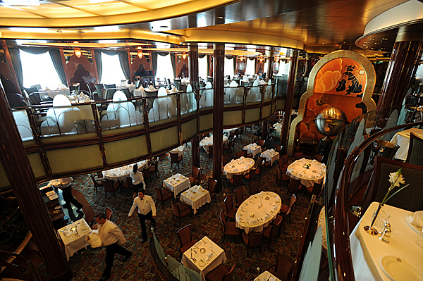 Waiters and waitress scurry about the Britannia Restaurant on the Queen Victoria before lunch service on Wednesday, September 30, 2009 as the ship sat at anchor in the waters off Bar Harbor. (Bangor Daily News/Kevin Bennett)