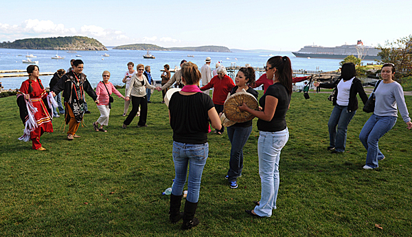 Penobscot Indians, Donna and Jason Brown, left, hold hands as they lead both locals and visitors from the Queen Victoria on a dance in Agamont Park on Wednesday, September 30, 2009. Drumming and singing for the dancers is Suckulis made up of Eve Dana, back to camera, Gabrielle Fields-Love,center, and Gloria Decontie, sister to Donna Brown. (Bangor Daily News/Kevin Bennett)