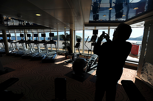 Maine Senator Dennis Damon uses his phone to take a picture of the fitness area aboard the Queen Victoria as it sits at anchor in the waters off Bar Harbor on Wednesday, September 30, 2009.
