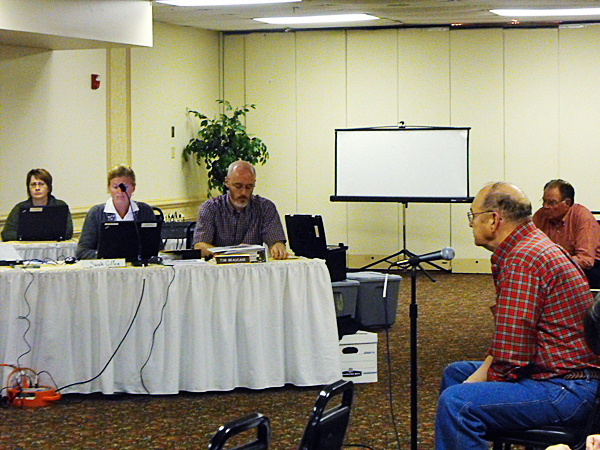 Ted Roberts, center, of Presque Isle, testifies before the Land Use Regulation Commission Wednesday afternoon. LURC has held hearings throughout the state to discuss changes to the draft Comprehensive Land Use Plan. Less than 20 people showed up at an afternoon public hearing to talk about revisions to the approximately 200 page plan. Of those, only a few testified for or against the changes. (BANGOR DAILY NEWS PHOTO BY JEN LYNDS)