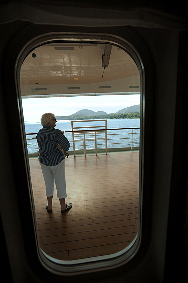 A passenger aboard the Queen Victoria pauses to take in the panoramic view of Mt. Desert Island and Bar Harbor as the vessel sits at anchor in the harbor on Wednesday, September 30, 2009. (Bangor Daily News/Kevin Bennett)