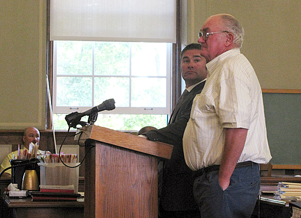 ROCKLAND -- Edwin Vance Bunker (r) and his attorney, Philip Cohen of Waldoboro, stand before the judge Wednesday morning in Knox County Superior Court. Bunker pleaded not guilty at the arraignment hearing about charges which stem from the July shooting incident on the Matinicus town dock. Bunker, 68, is accused of shooting fellow island lobsterman Chris Young, 41, in the neck.(Bangor Daily News photo by Abigail Curtis)