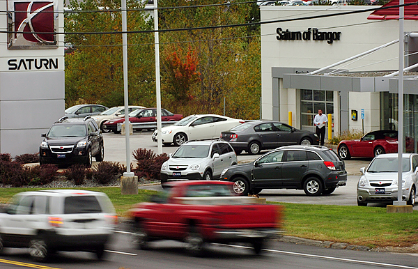 Vehicles drive on Hogan Road past a Bangor Saturn dealership Thursday, Oct. 1, 2009, the day that General Motors announced it would stop making Saturns and will close down the brand after a deal fell through with Penske Automotive Group Inc. (Bangor Daily News/Bridget Brown)