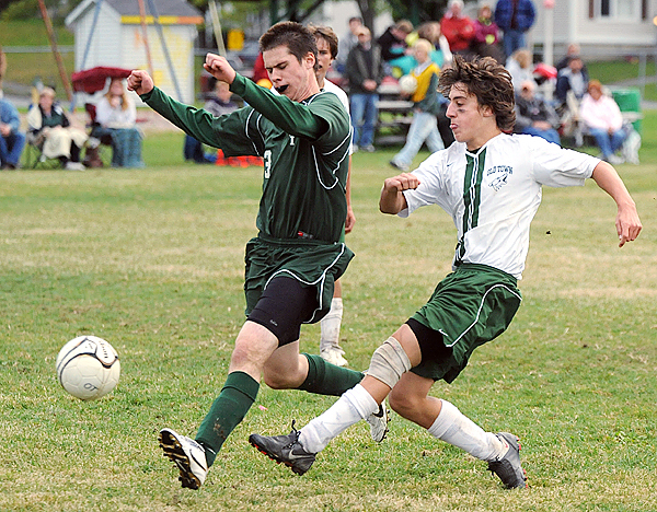Mount Desert Island High School's Dennis O'Neil (left) tries to block a shot by Old Town's Jared Winchenbach during the second half of the game in Old Town Thursday afternoon.   (Bangor Daily News/Gabor Degre)