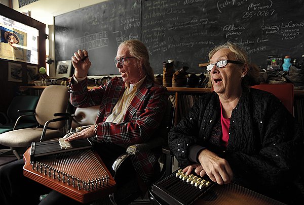 University of Maine at Machias music instructor Gene Nichols, left, gives an autoharp lesson to Marylena Graves, right, on Tuesday, September 22, 2009, in his music lab, which is filled with 25 years' worth of collecting music memorabilia, including shoes, ties, and musical instruments made from everyday items. (Bangor Daily News/Kevin Bennett)