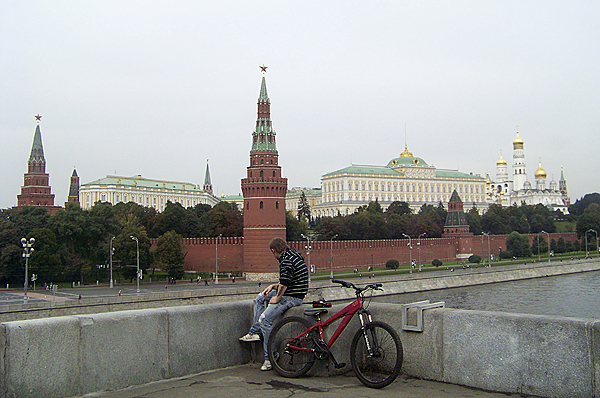 FYI, the guy on the bike in the first picture is not me or my friend Ellery.  A Russian cyclist takes a break on a bridge over the Moskva river which looks on to Moscow's Kremlin, the walled citadel of the city which houses the buildings of the presidential administration and many ornate churches. (Levi Bridges photo)