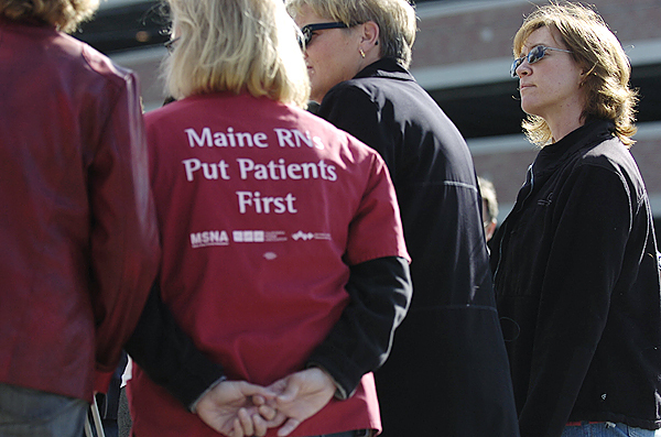(BANGOR DAILY NEWS PHOTO BY JOHN CLARKE RUSS)  CAPTION  Right to left:Tina Fife-Mahoney,R.N, (a neonatal intensive care nurse at EMMC), Cokie Giles (President of the Maine State Nurses Association), Andrea Longley,R.N. ( an I.C.U. nurse at EMMC) and Barbara Lambarida (a labor representative for MSNA) gathered across State Street from EMMC Friday morning  to talk with the media Friday morning about EMMC's efforts to cut back pediatric nursing staff. (Bangor Daily News/John Clarke Russ)
