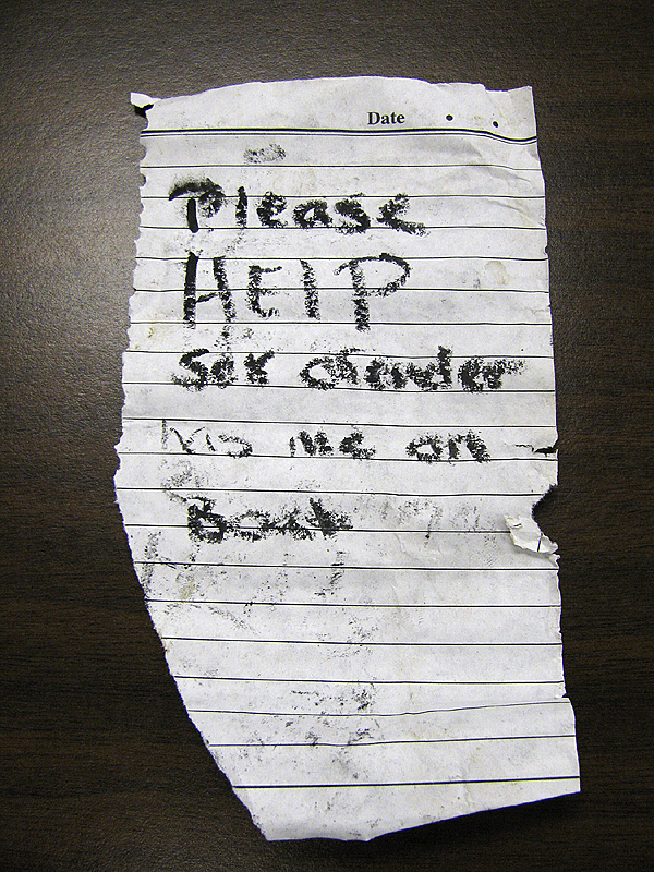 This note, which was found by a boater in Belfast harbor Thursday evening, is scrawled with black crayon on what appears to be a piece of paper torn from an appointment book. The Sprite bottle apparently is from a series that first was distributed a week and a half ago, said Belfast Police Chief Jeffrey Trafton.  (Bangor Daily News photo by Abigail Curtis)