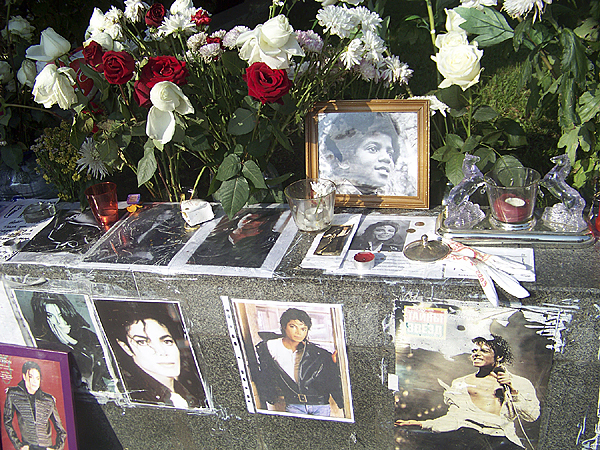 A world in mourning: pictures of the late Michael Jackson, bouquet's of flowers, as well as letters written to the former pop icon, adorn a sidewalk in central Moscow in a small memorial made by adoring Russian fans. (Levi Bridges photo)