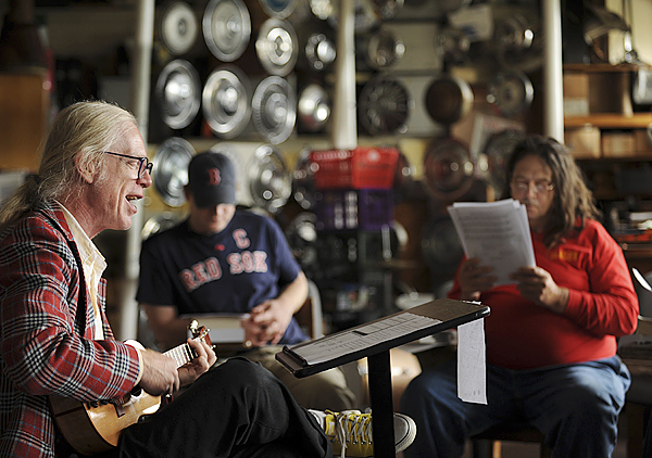 (BANGOR DAILY NEWS PHOTO BY KEVIN BENNETT)CAPTIONUniversity of Maine at Machias music professor Gene Nichols, left, leads a classon Bob Dylan with his ukulele on Tuesday, September 22, 2009 in his music lab filled with shoes, ties, musicmemorabilia and instruments made from ordinary items. (Bangor Daily News/Kevin Bennett)