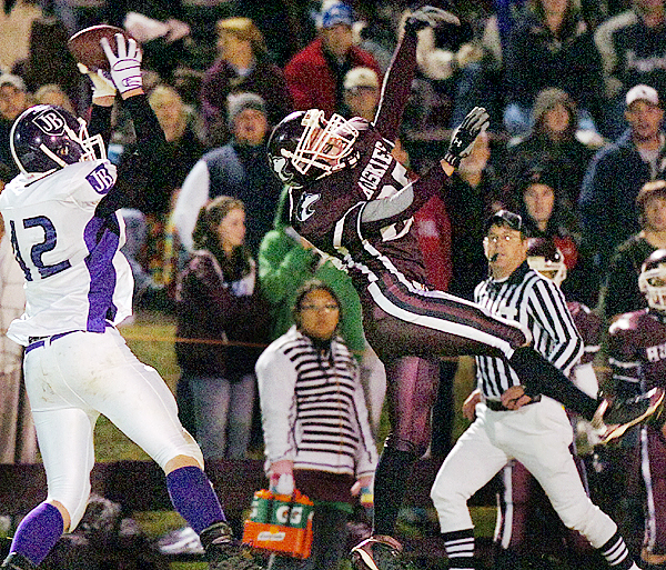 John Bapst's Max Andrews (left) catches a pass behind Maine Central Institute's Hunter Tibbetts (right) in the first half of Friday's game, Oct. 2, 2009 in Pittsfield. (Bangor Daily News/Bridget Brown)