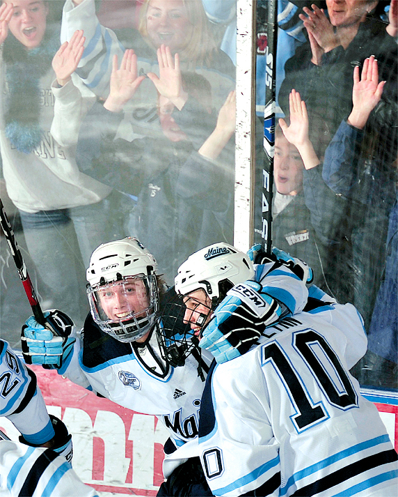 The University of Maine's Gustav Nyquist and Brian Flynn (10) celebrate Flynn's game-winning goal with 1:34 remaining in the Black Bears' 2-1 victory over Boston College at Alfond Arena Sunday.  (BANGOR DAILY NEWS PHOTO BY MICHAEL YORK)    CAPTION    Maine's Mike Banwell, left, and Brian Flynn celebrate Flynn's winning goal in their Hockey East game versus Boston College in Orono. (Bangor Daily News Photo by Michael York)