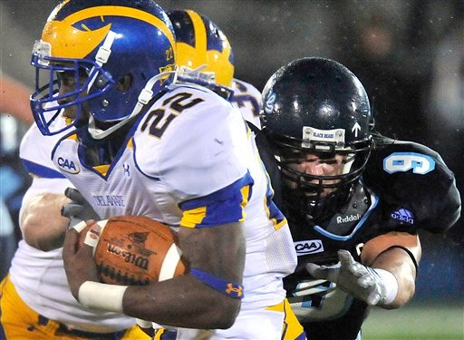 Delaware running back Leon Jackson (22) evades Maine defensive back Jordan Stevens (9) in the second half of an NCAA football game in Orono, Maine, Saturday, Oct. 3, 2009. (AP Photo/Michael C. York)