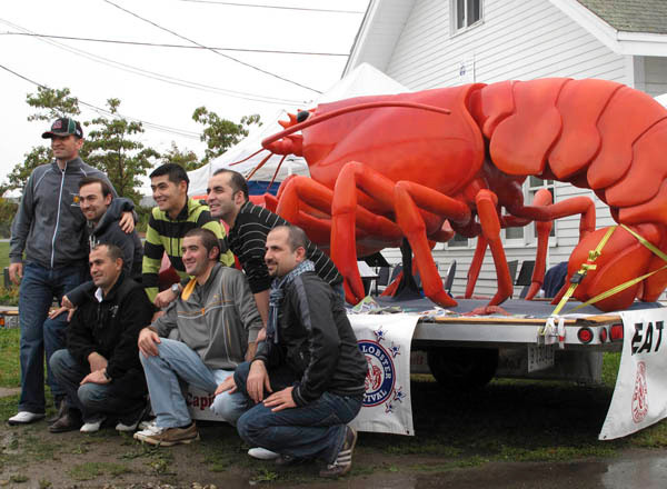 A group of Turkish men aboard the cruise ship Jewel of the Sea pose beside a giant lobster in Harbor Park in downtown Rockland on Sunday, Oct. 4, 2009. Sunday's visit by the 2,500-passenger Royal Caribbean ship was the first time a cruiseliner ported in Rockland.(Bangor Daily News/Kevin Miller)