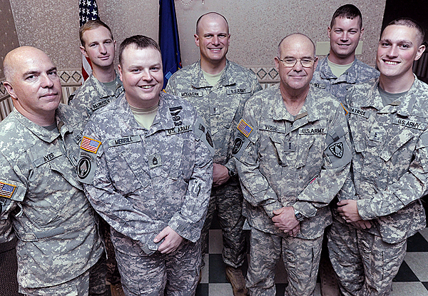 Freedom Salute Award recipients form the Army National Guard's Operational Support Airlift Command (left to right): Benjamin Ayer (CW4) of Newport, Dane Rasmussen (CW2) of Winterport, Bradley Merrill (SFC) of Augusta, Michael McGovern (CW3) of Eddington, Darrell Vigue (CW4) of Glenburn, Peter Beloff (SFC) of Hampden and Benjamin Patrick (CW2) of Stockton Springs following Sunday morning's Freedom Salute Presentation at the Spectacular Events Center in Bangor. The even a the Spectacular Events Center Sunday , October 4, 2009 honored these seven men as well two members of the Embedded Training Team (Michael R. Wall (SFC) of Rockland and Duane M. Rancourt (SFC) of Fairfield Center,ME)  and two Individual Mobilization members (Mark Wright (LTC) of Fort Ann, NY and SGT Francis S. LeBlanc, Jr. of Acton,ME)--all members of the Maine Army National Guard. (Bangor Daily News/John Clarke Russ)