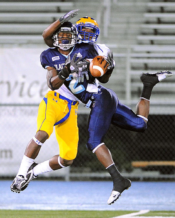The university of Maine's Landis Williams cant make the catch on a long pass due to interfearance by the Delaware's Anthony Walters during the first quarter of the game in Orono Saturday evening.  The Black Bears lost the game 27-17. (Bangor Daily News/gabor Degre)