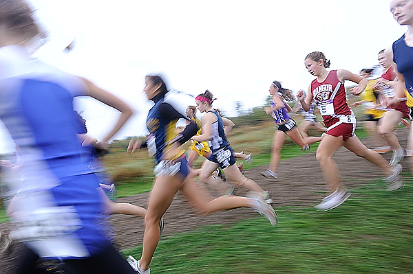 Rachel Huber (#8, right) of Bangor High School and other girls take off from the start of their seeded race of the 2009 Maine Cross Country  Festival of Champions in Belfast Saturday afternoon, October 3, 2009. Huber ran the 5K course in 21:43.3, placing 61st. (Bangor Daily News/John Clarke Russ)