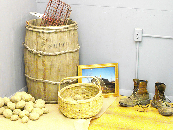Potatoes, a basket and a beat-up pair of work boots were common items used during the height of Aroostook County's potato harvest. To rekindle memories of that time,The Blue Moon Gallery in Houlton recently opened its newest exhibition, &quotArt of the Harvest,&quot inside Visions, its Main Street store. The display will be up until Oct. 25 (BANGOR DAILY NEWS PHOTO BY JEN LYNDS)