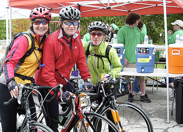 With 20 miles left to go Sue Leavitt (left), Audrey Caswell (center) and Carin D'Abrosca were all smiles during the 50-mile ride of the inaugural Dempsey Challenge in Lewiston. (Bangor Daily News/Julia Bayly)
