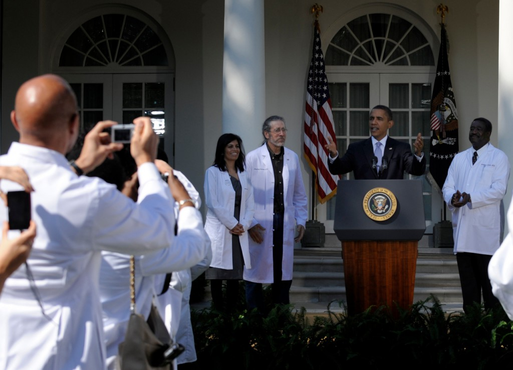 President Barack Obama arrives in the Rose Garden of the White House in Washington, Monday, Oct. 5, 2009, to address doctors from across the country. From left are, Dr. Mona Mangat of St. Petersburg, Fla.; the president; Dr. Hershey Garner of Fayetteville, Ark.; and Dr.Richard Evans of Dover-Foxcroft, Maine. (AP Photo/Susan Walsh)