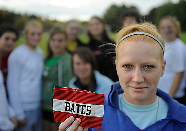 Last month the Orono Red Riots girls soccer team began wearing a a memorial armband as a tribute to Collin Bates, Orono High School Class of 2008. Collin Bates died early last month. Holding up the armband is Collin Bates' sister, Alyssa Bates, a senior and a co-captain of the school's soccer team. Photographed with her teammates before their practice Tuesday afternoon, October 6, 2009. (Bangor Daily News/John Clarke Russ)