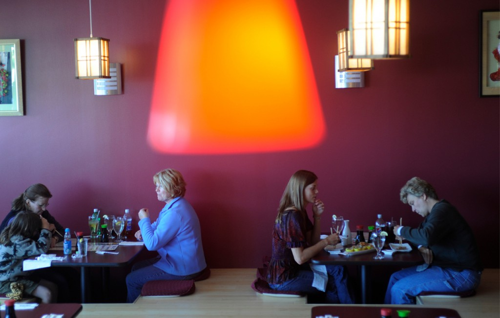 Patrons enjoy lunch recently at the newly opened Yoshi Japanese Restaurant and sushi bar at 373 Wilson St. in Brewer. Buy Photo