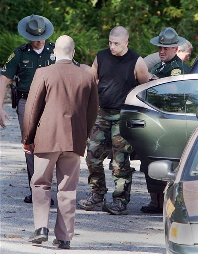 Christopher Gribble, 19,  is escorted into  District Court in Milford, N.H., Tuesday, Oct. 6,2009 for his arraignment on first-degree murder. Gribble is one of four teenagers charged in an attack that left  42-year-old Kimberly Cates dead and seriously injuring her daughter. (AP Photo/Jim Cole)