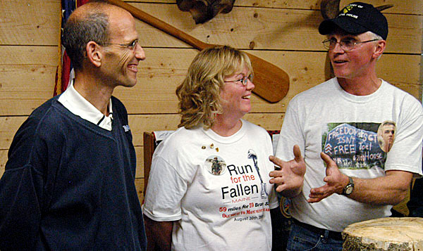 Paul and Dee House of Lee joke with Gov. John Baldacci at House in the Woods, Inc., A Military and Family Retreat. The Lee-based enterprise operated by the House family and their friends will help veterans and their families cope with their grief and readjustment to civilian life by guiding them through the Maine woods, which Baldacci came to Lee on Wednesday to support. (Bangor Daily News/Nick Sambides Jr.)