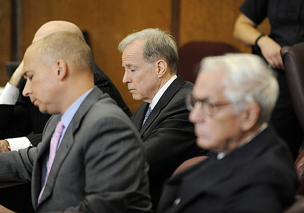 Francis Morrisey, center, closes his eyes as a guilty verdict is read in a courtroom in New York, Thursday, Oct. 8, 2009.  Brooke Astor's 85-year-old son Anthony Marshall was convicted Thursday of exploiting his philanthropist mother's failing mind and helping himself to her nearly $200 million fortune.  His co-defendant, estate lawyer Francis X. Morrissey Jr., was convicted on five charges, including scheming to defraud, conspiracy and forgery.  (AP Photo/ Steven Hirsch, Pool)