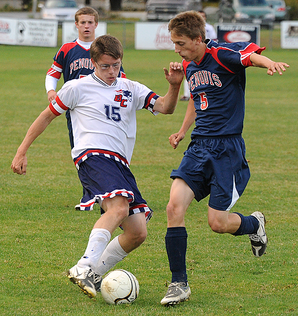 Bangor Christian's Nate Fowler (right) battles for the ball with Penquis High School's Colby Brown during the first half of the game in Bangor Thursday evening. (Bangor Daily News/Gabor Degre)