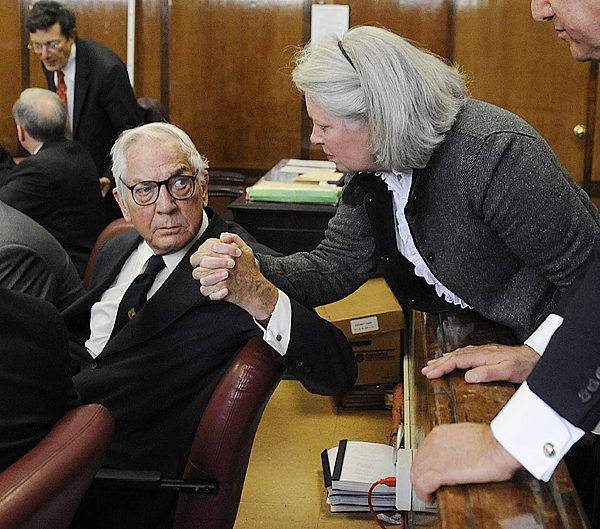 Anthony Marshall and his wife Charlene Marshall clasp hands in a courtroom in New York, Thursday, Oct. 8, 2009.  Brooke Astor's 85-year-old son Marshall was convicted Thursday of exploiting his philanthropist mother's failing mind and helping himself to her nearly $200 million fortune. (AP Photo/ Steven Hirsch, Pool)