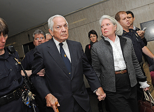 Anthony Marshall, Brooke Astor's 85-year-old son, center, exits Manhattan State Supreme Court with wife Charlene, right, Thursday, Oct. 8, 2009, in New York. A jury found  Marshall Thursday guilty of exploiting his philanthropist mother's failing mind and helping himself to her nearly $200 million fortune.  (AP Photo/ Louis Lanzano)