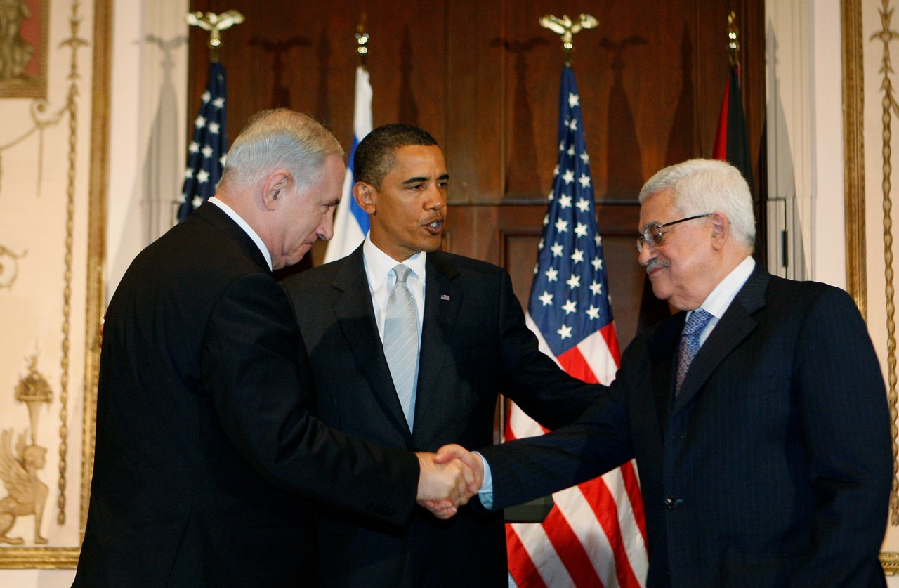 File - President Barack Obama watches as Israeli Prime Minister Benjamin Netanyahu and Palestinian President Mahmoud Abbas shake hands, in this Sept. 22, 2009 file photo taken in New York. President Obama won the 2009 Nobel Peace Prize Friday Oct. 9, 2009 for &quothis extraordinary efforts to strengthen international diplomacy and cooperation between peoples,&quot the Norwegian Nobel Committee said, citing his outreach to the Muslim world and attempts to curb nuclear proliferation. (AP Photo/Charles Dharapak, File)