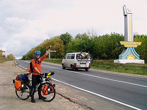 Levi Bridges poses for a picture in front of a monument marking the boundary of the last Russian province the two cyclists entered on their 6,000 mile bicycle trip across Russia. The two spent nearly half a year cycling across the country from the Sea of Japan in Asia and across Siberia into Eastern Europe.  (Levi Bridges Photo)