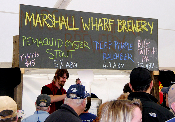A homemade sign advertises the offerings from the Marshall Wharf Brewery of Belfast Saturday at the 14th annual Oktoberfest sponsored by the Southwest Harbor-Tremont Chamber of Commerce. The festival attracted thousands of people who came to sample the samples of Maine-made beers and wines, local foods and a variety of crafts.   BANGOR DAILY NEWS PHOTO BY RICH HEWITT