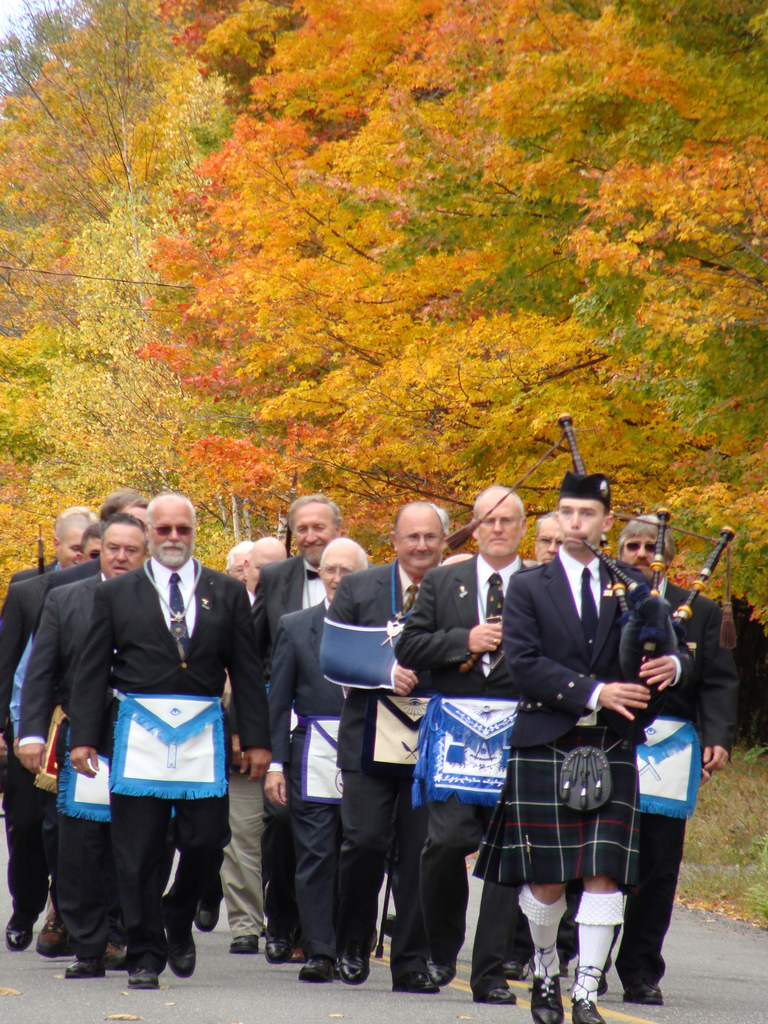 Lead by Sean Fluet of East Madison on the bagpipes, Master Masons from  throughout Piscataquis County marched on Saturday from the Moses  Greenleaf homestead to a monument in his honor in Williamburg. The march  and a ceremony honored Maine's first cartographer and the first  Worshipful Master of the Piscataquis Masonic Lodge in Milo. (Bangor  Daily News Photo by Diana Bowley)